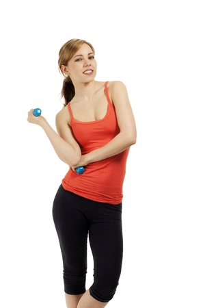 young confident smiling fitness woman with dumbbells on white background photo