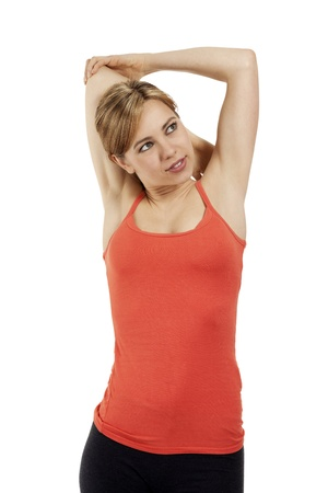 young smiling fitness woman stretching her arms on white background photo
