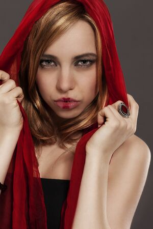 beautiful woman with a red scarf red riding hood like photo