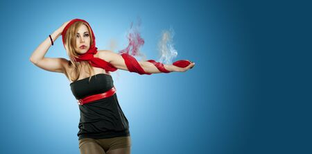 beautiful woman with red scarf in front of a blue background and a smoking arm Stock Photo - 14748441