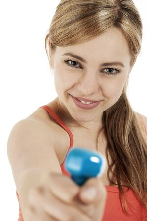closeup of a blonde fitness woman with a dumbbell on white background photo