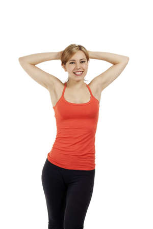 blonde young fitness woman with her arms in her neck on white background photo
