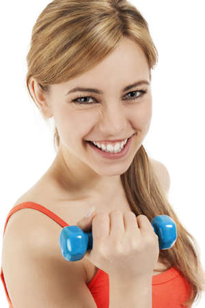 happy young blonde woman with a dumbbell on white background photo