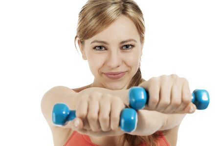 cute fitness woman exercising with blue dumbbells on white background photo