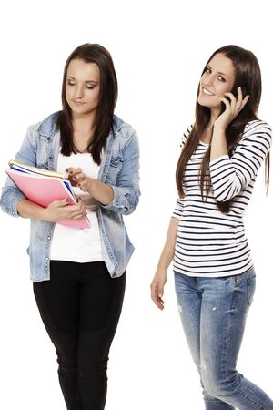 two young students one hanging on the phone on white background photo
