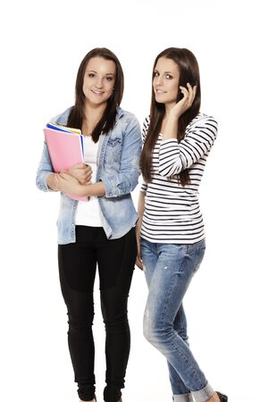 one student calling by phone near her friend with notepads on white background Stock Photo - 15177704