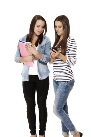 happy teenage students looking at a smartphone on white background Stock Photo - 15177705