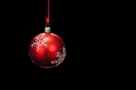 hanging red dull christmas ball on black background photo
