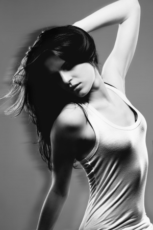 beautiful sensual woman moving her hair in black and white photo