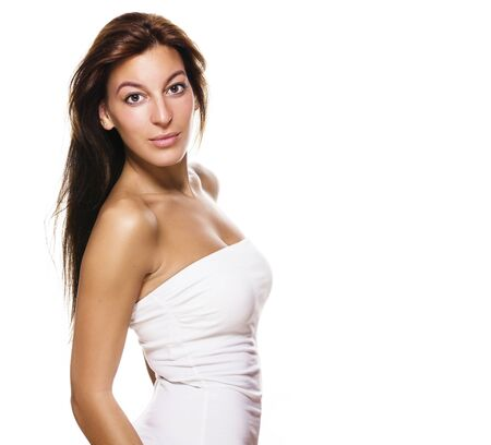 head on shoulder: beautiful woman turning around on white background