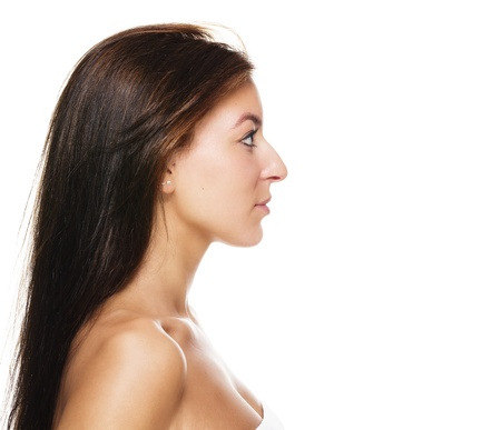 long nose: side view of a beautiful brunette woman on white background