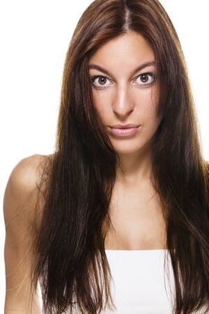 tense looking beautiful brunette woman with long hair photo
