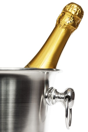 closeup of a bottle of champagne in a champagne bucket on white background