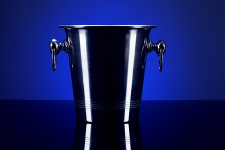 empty champagne bucket on a mirror with blue background Stock Photo - 16005160