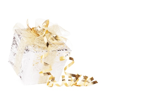 beautiful silver christmas present with golden ribbons and streamer on white background
