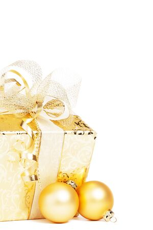 beautiful golden christmas present with golden christmas balls on white background Stock Photo - 16005159