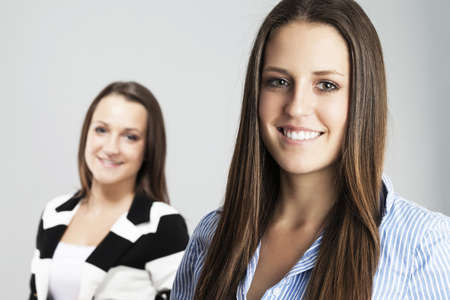 happy brunette teenager in front of other teenager Stock Photo - 17413632