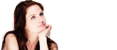 portrait of a beautiful dreaming woman on white background photo