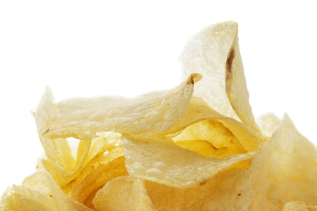 closeup of salted potato chips on white background Stock Photo