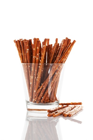 pretzel sticks in a glass on white background photo