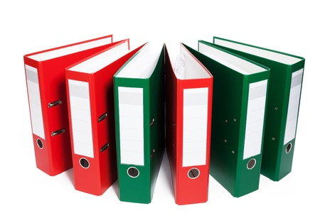 organized office: half circle of red and green ring binders on white background