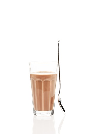 chocolate shake: chocolate milk with a standing spoon on white background