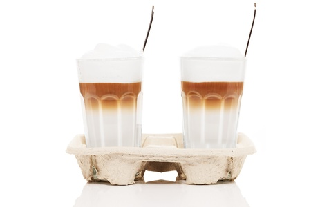 go inside: latte macchiato to go with coffee spoons inside on white background