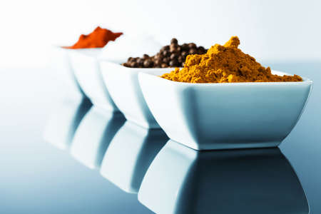 curry powder: spices in small bowls in row with blue light