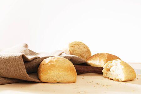 freshly: wheat buns and broken wheat bun with linen fabric