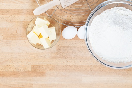 baking ingredients from top on wooden background photo