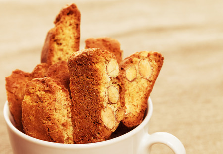 closeup of coffee cantuccini cookies in a cup photo