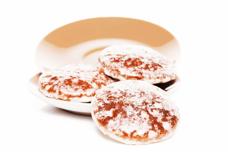 traditional german lebkuchen gingerbread cookies slipping from plates photo