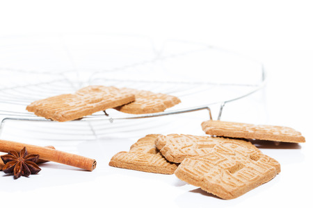traditional spicy almond spekulatius christmas cookies with a cooling grid cinnamon and aniseed Stock Photo - 22857775
