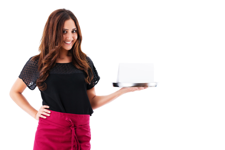 happy waitress holding tray with a blank card on white background photo