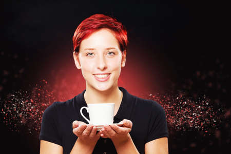 happy redhead woman holding a white cup of coffee with both hands photo