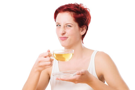 woman disgusted from the tea on white background photo