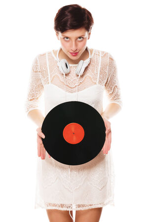 diabolic: cute redhead woman looking diabolic holding a vinyl record Stock Photo