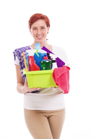 happy redhead woman with cleaning utensils on white background photo