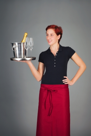serving tray: happy young waitress serving champagne on a tray