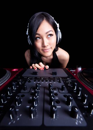 deejay: Wide angle shot of a female DJ using the fader.