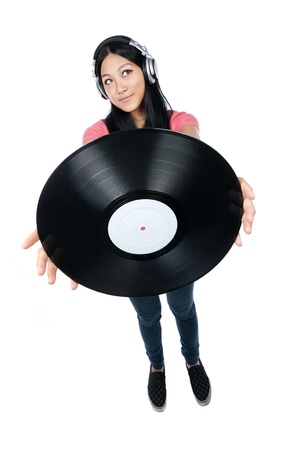 deejay: Female Asian DJ holding a record out