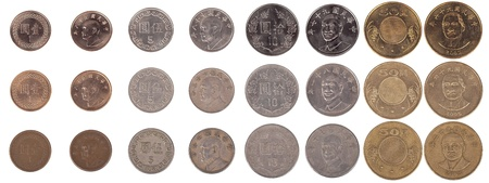 Large pile of Taiwanese coins shot from straight above. The pile includes 1, 5, 10 and 50 New Taiwan dollar coins. Stock Photo