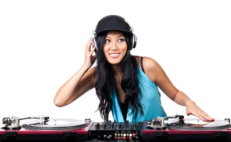 turntables: A young Asian girl with a big smile DJing on turntables Stock Photo