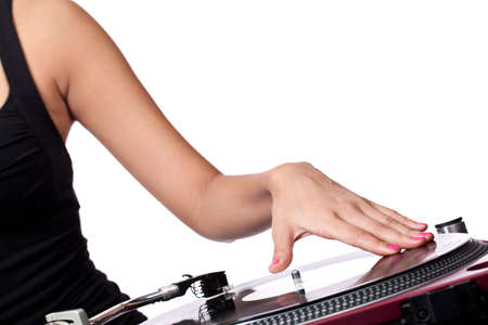 A female hand queing up a record on a turntable photo