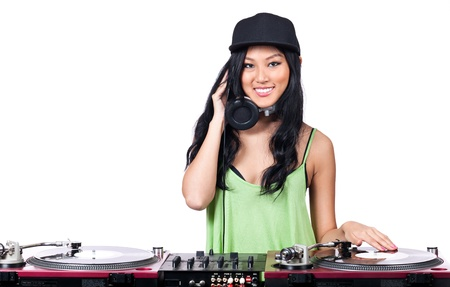 A young Asian girl dressed in black and green DJing. photo