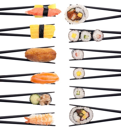 Set of 12 different pieces of sushi forming 2 rows isolated on white.