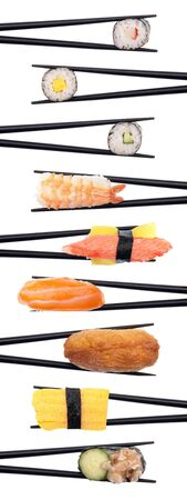 Set of 9 pieces of sushi being held with black chopsticks making a row isolated on white. Standard-Bild