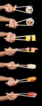 Set of 7 hands holding various types of sushi with chopsticks isolated on a black background. photo