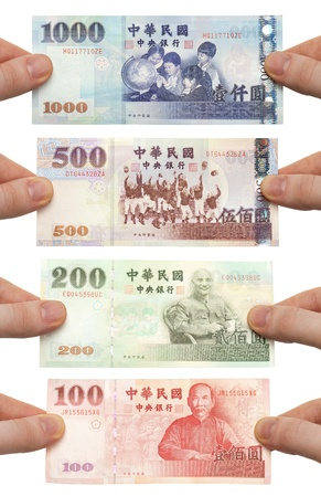 nt: Hands holding out 100, 200, 500 and 1000 New Taiwan Dollar bills. Stock Photo