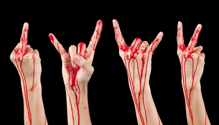 bloodstains: A composite of 4 bloody covered hands making various gestures isolated on black.